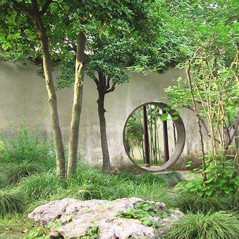 Rundes Eingangstor zu Garten, Asien